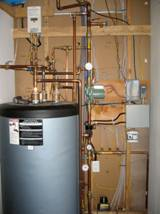 Mechanical room shows the single pump that operates solar collection, domestic hot water heating, and radiant floor heat distribution.